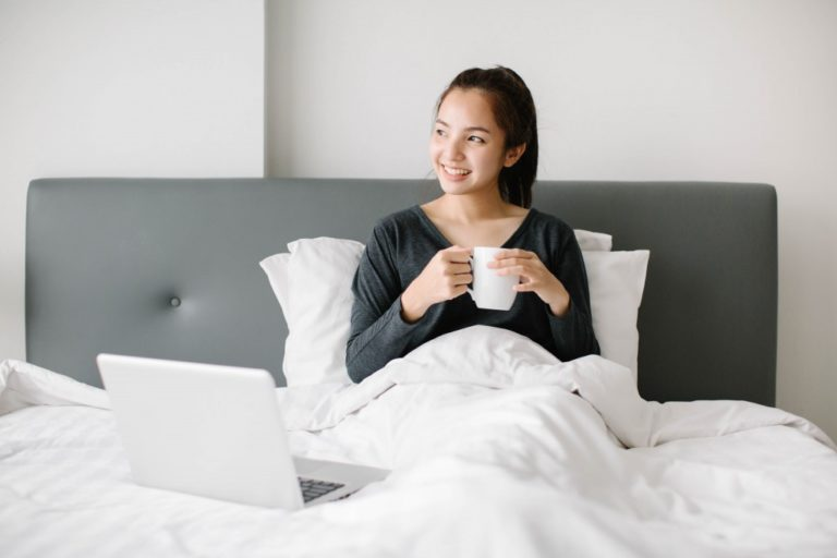 woman having her coffee in bed