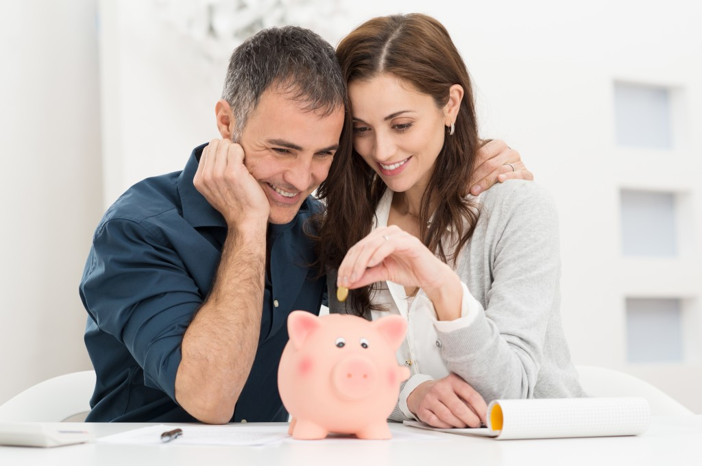 couple looking at piggy bank