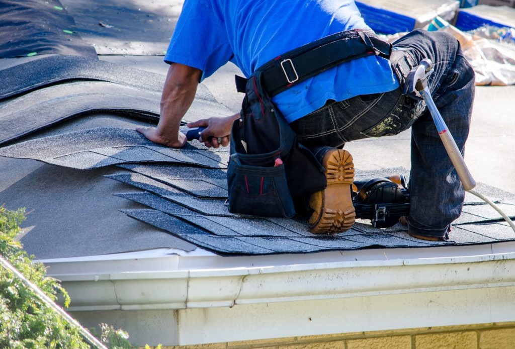man fixing the roof