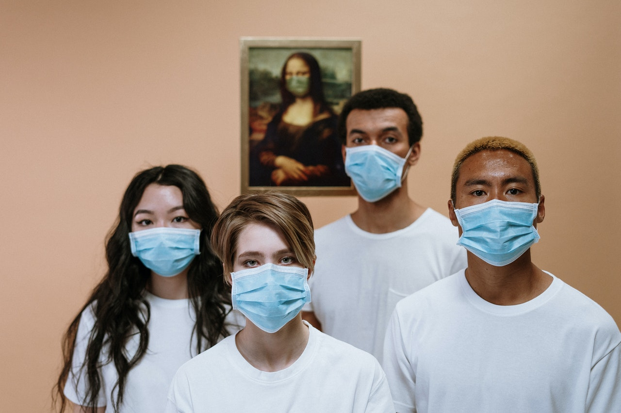 a group of people wearing a face mask