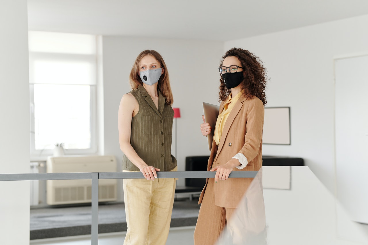 women wearing masks at the office