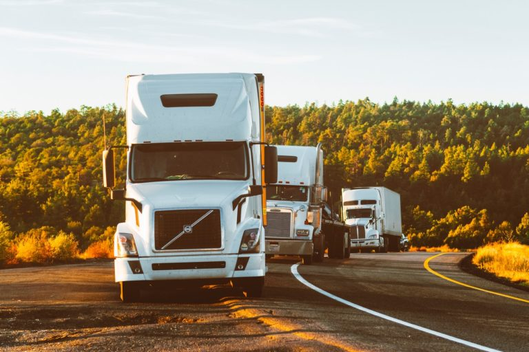 a fleet of trucks on the road