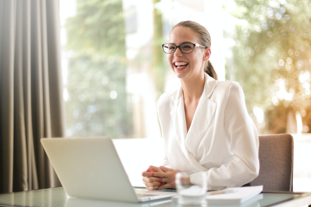woman sitting at her desk in front of her laptop