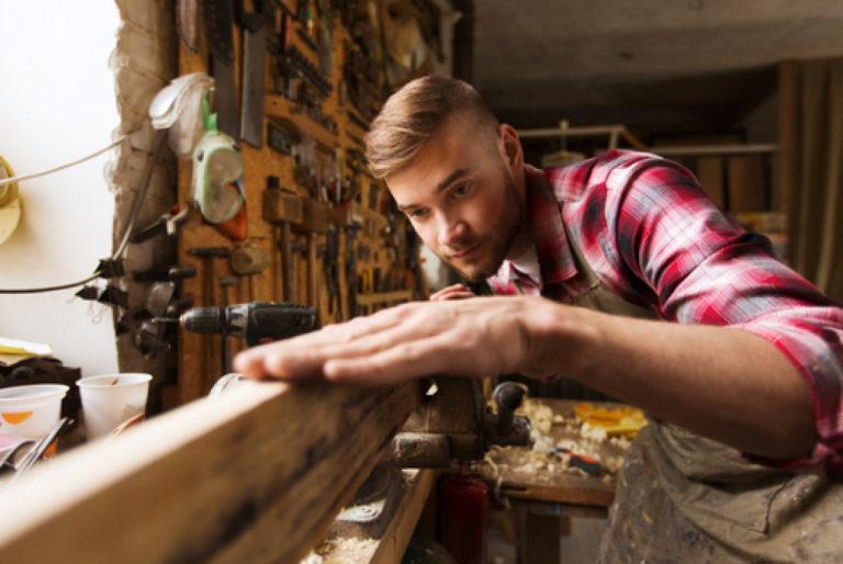 man leveling wood