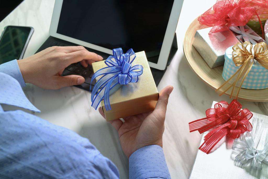 man holding a present