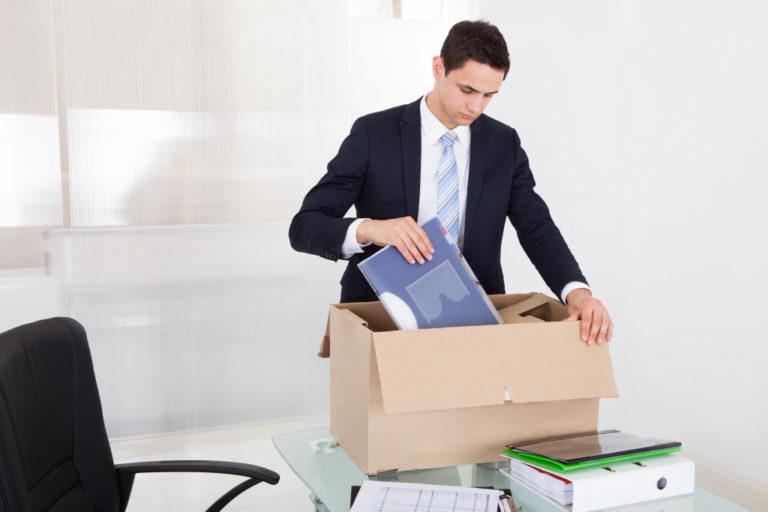 man packing his things