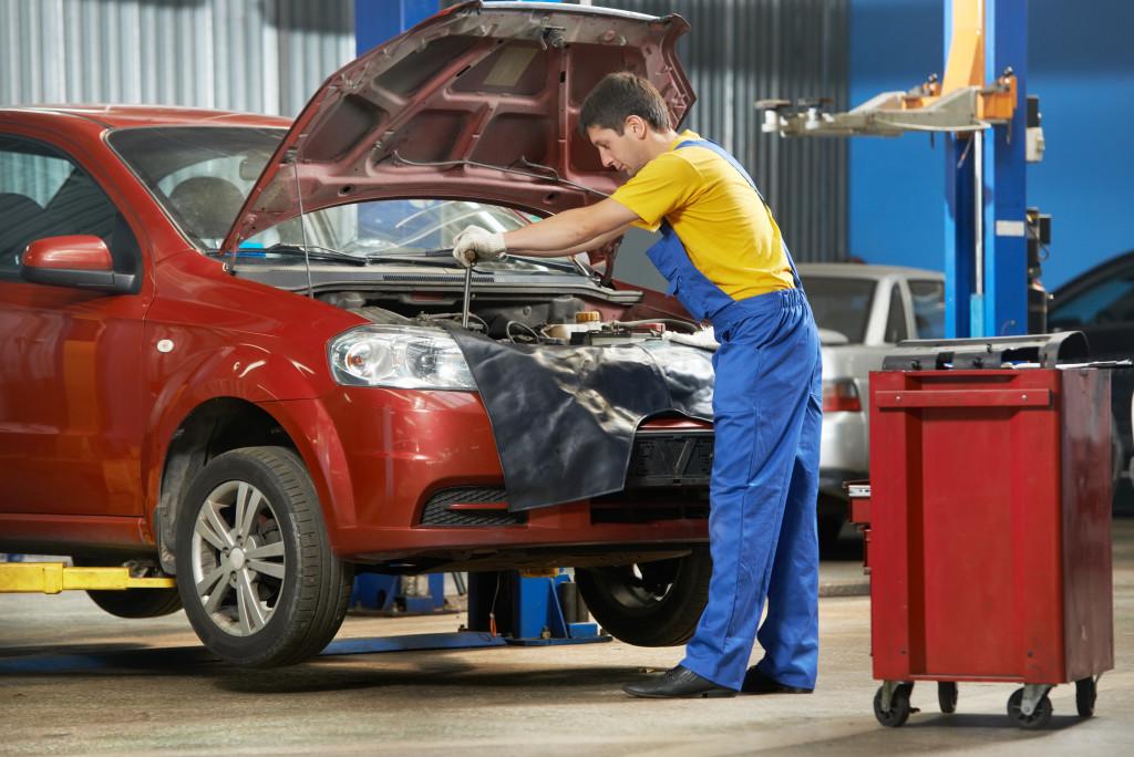 car mechanic working on car